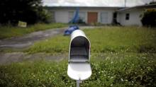 An empty mail box is seen at the front door of a foreclosed house in Miami Gardens, Florida in this Sept. 15, 2009 file photo. (Carlos Barria/Reuters/Carlos Barria/Reuters)