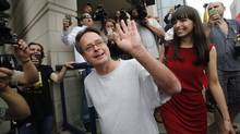 Marijuana advocate Marc Emery waves to his supporters in Windsor, Ont., on August 12, 2014, as he walks with his wife Jodie following his return to Canada after release from an American prison for selling marijuana seeds in the U.S. (Rebecca Cook/Reuters)