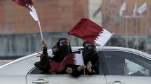 Qatari women wave the national flag as they celebrate in Doha December 3, 2010. FIFA gave its ultimate recognition to emerging markets on Thursday by awarding the 2018 and 2022 editions of the prestigious and lucrative World Cup soccer finals to Russia and Qatar, both new hosts. (FADI AL-ASSAAD/REUTERS/REUTERS/FADI AL-ASSAAD)