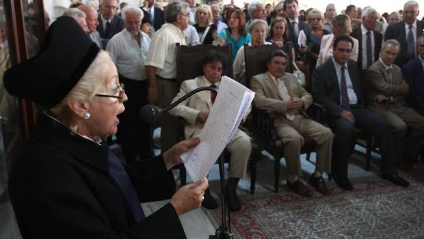 The head of Greece's Association of Judges and Public Prosecutors, Vassiliki Thanou, reads aloud a speech during a protest of judicial officials at the country's Supreme Court building, in Athens, Wednesday, Sept. 5, 2012. Judges and prosecutors are threatening to cut court hours in response to pay cuts expected as part of a massive new austerity package demanded by Greece's rescue creditors. (THANASSIS STAVRAKIS/AP)