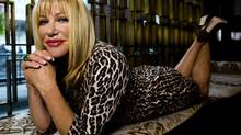 """Actress and author Suzanne Somers poses for a photograph in Toronto on Tuesday, Oct. 1, 2013. Somers has new book entitled """"I'm Too Young For This."""" (Nathan Denette/THE CANADIAN PRESS)"""