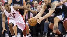 Toronto Raptors guard Kyle Lowry, left, battles for the loose ball against Minnesota Timberwolves centre Nikola Pekovi, right, during first half NBA action in Toronto on Sunday, Nov. 4, 2012. (Nathan Denette/THE CANADIAN PRESS)
