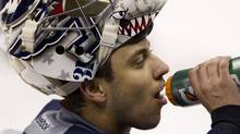 Winnipeg Jets goalie Ondrej Pavelec (31) takes a drink during a team practice in Winnipeg, Saturday, Oct. 8, 2011. The Jets will play the Montreal Canadiens in their inaugural game on Sunday. THE CANADIAN PRESS/Jonathan Hayward (JONATHAN HAYWARD)