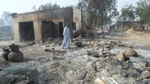 A man walks past burnt out houses following an attack by Boko Haram in Dalori village 5 kilometres (3 miles) from Maiduguri, Nigeria, Sunday Jan. 31, 2016. (Jossy Ola/AP)
