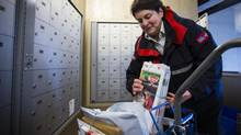 Suzanne Gamache a 31-year Canada Post employee delivers mail and parcels to business and condo towers in Vancouver December 11, 2013. (John Lehmann/The Globe and Mail) (John Lehmann/The Globe and Mail)
