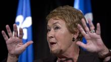Pauline Marois responds to a question during a news conference on Wednesday after her party won a minority victory. (The Canadian Press)