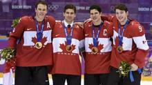 Men's hockey gold medalists, from left, Jonathan Toews, John Tavares, Sidney Crosby and Matt Duchene pose with their medals after beating Sweden 3-0 in the gold medal final at the Sochi Winter Olympics Sunday, February 23, 2014 in Sochi. (Paul Chiasson/THE CANADIAN PRESS)
