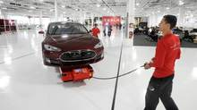 Tesla shares are hardly cheap, with a price-to-earnings ratio of around 50, but the company has a bright future. (Noah Berger/REUTERS)