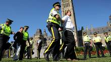 Protesters are arrested as the Council of Canadians and Greenpeace Canada hold a rally featuring a civil disobedience sit-in against the tar sands on Parliament Hill in Ottawa on Sept. 26, 2011. (Sean Kilpatrick/The Canadian Press/Sean Kilpatrick/The Canadian Press)