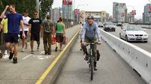 Vancouver mayor Gregor Robertson rides his bike in the newly designated bicycle lane on the Burrard Street Bridge in Vancouver July 12, 2009. (Jeff Vinnick/The Globe and Mail/Jeff Vinnick/The Globe and Mail)