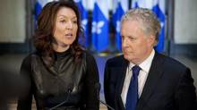 Deputy premier Nathalie Normandeau announces her resignation as Quebec Premier Jean Charest looks on September 6, 2011. (Jacques Boissinot/The Canadian Press)