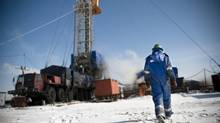 A man walks back to work at an oil rig drill. (iznashih/Getty Images/iStockphoto)