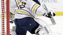 Buffalo Sabres goalie Ryan Miller looks back as a shot by the Tampa Bay Lightning hits the post during the second period of an NHL hockey game Tuesday, March 26, 2013, in Tampa, Fla. (Chris O'Meara/AP)