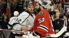 Los Angeles Kings goalie Jonathan Quick greets Chicago Blackhawks goalie Corey Crawford after the Kings defeated the Blackhawks 5-4 in the overtime period in Game 7 of the Western Conference finals in the NHL hockey Stanley Cup playoffs Sunday, June 1, 2014, in Chicago. (Nam Y. Huh/AP)