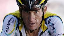 In this July 19, 2009, file photo, Lance Armstrong crosses the finish line during the 15th stage of the Tour de France cycling race in Verbier, Switzerland. Armstrong confessed to using performance-enhancing drugs to win the Tour de France during a taped interview with Oprah Winfrey that aired Thursday, Jan. 17, 2013, reversing more than a decade of denial. (LAURENT REBOURS/AP)