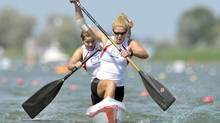 Canada's Laurence Vincent-Lapointe, front, and Mallorie Nicholson, back, paddle to win the 500 meters C2 women's final race at the Canoe Sprint World Championships in Szeged, Hungary, Saturday, Aug. 20, 2011. A British woman is launching a court challenge against organizers of the 2012 London Summer Olympics over the exclusion of women's canoe racing events – and several Canadians, including Vincent-Lapointe, are an important part of the fight. (Bela Szandelszky/AP)