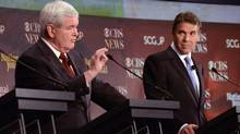 Republican presidential candidate Newt Gingrich, left, speaks while fellow candidate Rick Perry awaits his turn during the the CBS News/National Journal foreign policy debate in Spartanburg, S.C., on Nov. 12, 2011. (Richard Shiro/AP/Richard Shiro/AP)