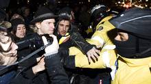 Occupy Toronto protesters clash with police while they march north on University Ave. in Toronto on Friday March 30, 2012. (Aaron Vincent Elkaim/THE CANADIAN PRESS)