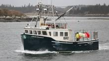 A lobster boat returns to Yarmouth, NS, December 5, 2012. Fishermen are receiving $3 per pound for their lobsters. (Paul Darrow for The Globe and Mail)