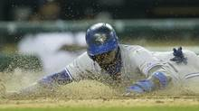 Toronto Blue Jays' Jose Reyes slides at home and scores on a single by teammate Melky Cabrera during the eighth inning of a baseball game Detroit Tigers in Detroit, Wednesday, June 4, 2014. (Carlos Osorio/AP)
