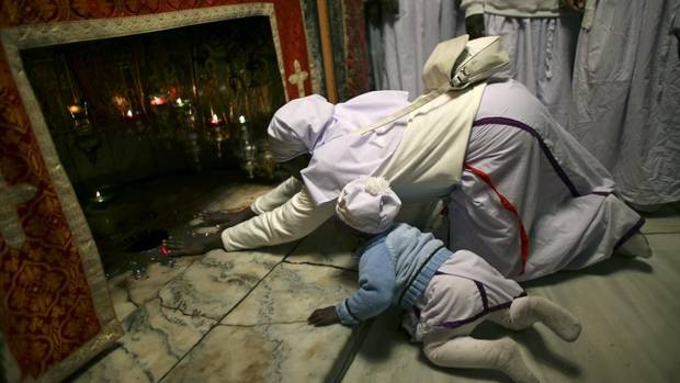Nigerian pilgrims pray in the grotto of the Church of Nativity in the West Bank town of Bethlehem December 24, 2012. The church is built over the grotto where Christians believe the Virgin Mary gave birth to Jesus. (Ammar Awad/Reuters)