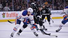 Los Angeles Kings centre Andy Andreoff battles for the puck with Edmonton Oilers right wing Nail Yakupov in the third period during an NHL game at Staples Center on Feb. 25, 2016. (Kirby Lee/USA Today Sports)