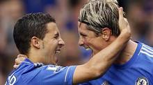 Chelsea's Eden Hazard (L) celebrates with team mate Fernando Torres after scoring against Newcastle United during their English Premier League soccer match at Stamford Bridge in London August 25, 2012. (STEFAN WERMUTH/REUTERS)