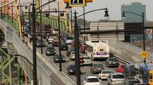 Afternoon rush hour traffic moves across the Angus L. Macdonald bridge in Halifax. Nova Scotia Premier Stephen McNeil says the federal plan would increase already high pump prices in the province. (Paul Darrow For The Globe and Mail)