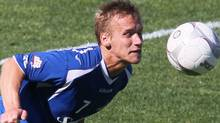 Montreal , QC, CAN; Montreal Impact midfield David Tiesto (7) heads the ball during the second half against the Fort Lauderdale Strikers at the Saputo Stadium. Jean-Yves Ahern-US PRESSWIRE (Jean-Yves Ahern/US PRESSWIRE)
