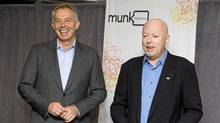 """Former British Prime Minister Tony Blair and author Christopher Hitchens pose ahead of their debate on religion set up by """"Munk Debates"""" in Toronto, Nov. 26, 2010. (Mark Blinch / Reuters/Mark Blinch / Reuters)"""