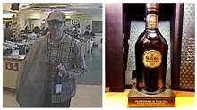 A suspect is captured on a surveillance video in a Toronto liquor store where police say he walked out with a $26,000 bottle of 50-year-old Glenfiddich scotch. (Handout/Toronto Police Service)