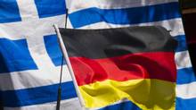 Greek and German national flags fly outside a Greek cafe in Berlin. (THOMAS PETER/Reuters)