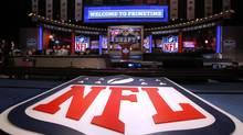 A large NFL logo decorates the stage during the NFL draft at Radio City Music Hall (JASON DECROW/AP)