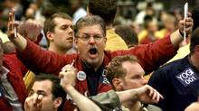 Traders signal on the trading floor in this file photo. (Scott Olson/Reuters)