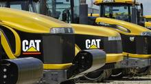 Caterpillar is writing off more than half-a-billion dollars on a deal it made to acquire a Chinese company. (Seth Perlman/AP)