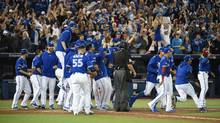 Edwin Encarnacion hit a three run home run in the bottom of the 11th to give the Blue Jays a 5-2 win. Toronto will play Texas in the ALDS. Game one is Thursday at 1:30pm. (Fred Lum/The Globe and Mail)