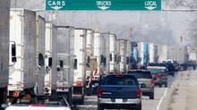 Truck traffic along Huron Church Road in Windsor, Ont. File photo. (Jason Kryk/CP)