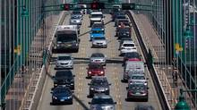 here are more pedestrians, more bicycles, more buses, more of many other things besides cars on the road in Vancouver. (Darryl Dyck/THE CANADIAN PRESS)