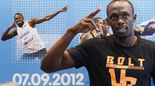 Jamaica's Usain Bolt gestures during a news conference ahead of the Golden League athletics meeting in Brussels (FRANCOIS LENOIR/REUTERS)