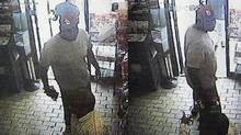 These images provided by the Ferguson Police Department show security camera footage from a convenience store in Ferguson, Mo., on Aug. 9, 2014, the day that Michael Brown was fatally shot by a police officer. A report released Friday, Aug. 15, 2014, by Ferguson Police Chief Thomas Jackson says the footage shows a confrontation between Brown and an employee at the store. (ASSOCIATED PRESS/FERGUSON POLICE DEPARTMENT)
