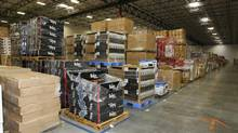 Merchandise sits at the Amazon.com warehouse in Goodyear, Ariz. in a file photo. Wal-Mart Stores Inc. is expanding its online business to try to catch up with e-commerce leader Amazon. (RICK SCUTERI/REUTERS)