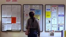A job seeker looks at job postings in Boston. (BRIAN SNYDER/REUTERS)