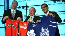 George Cope, president and CEO of Bell Canada and BCE, Lawerance Tanenbaum, chairman of Maple Leaf Sports and Entertainment and Nadir Mohamed, president and CEO, Rogers Communication hold jerseys from MLSE's four franchises. (Brett Gundlock for The Globe and Mail/Brett Gundlock for The Globe and Mail)