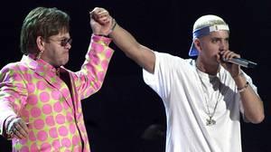 Elton John (left) performed with rap musician Eminem during the 43rd Grammy Awards in 2001.