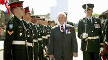 Governor-General David Johnston inspects an honour guard prior to delivering the Speech from the Throne in Ottawa on June 3, 2011. (DAVE CHAN/Reuters)