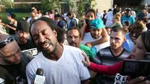 This May 6, 2013 file photo shows neighbour Charles Ramsey speaking to media near the home where missing women Amanda Berry, Gina DeJesus and Michele Knight were rescued in Cleveland. Ramsey lived next door to where Ariel Castro is alleged to have kept the women in his makeshift prison until Monday afternoon, when Ramsey happened to be home and heard Amanda Berry's scream. (Scott Shaw/AP/The Plain Dealer)