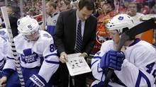 Toronto Maple Leafs assistant coach Scott Gordon shows a play to right wing Phil Kessel (81) and centre Tyler Bozak (42) in the third period of an NHL hockey game against the Washington Capitals Tuesday, Feb. 5, 2013 in Washington. The Maple Leafs won 3-2. (Alex Brandon/AP)