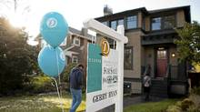 Potential purchasers make their way into an open house in the Kerrisdale neighbourhood of Vancouver, on January 15, 2012. (Rafal Gerszak For The Globe and Mail)