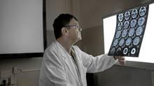 Paolo Zamboni in his studio at the University Hospital of Ferrara. (Alessandro Vincenzi For The Globe and Mail)