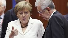 Germany's Chancellor Angela Merkel talks to Italy's Prime Minister Mario Monti, right, during a European Union leaders summit in Brussels June 29, 2012. (FRANCOIS LENOIR/REUTERS)